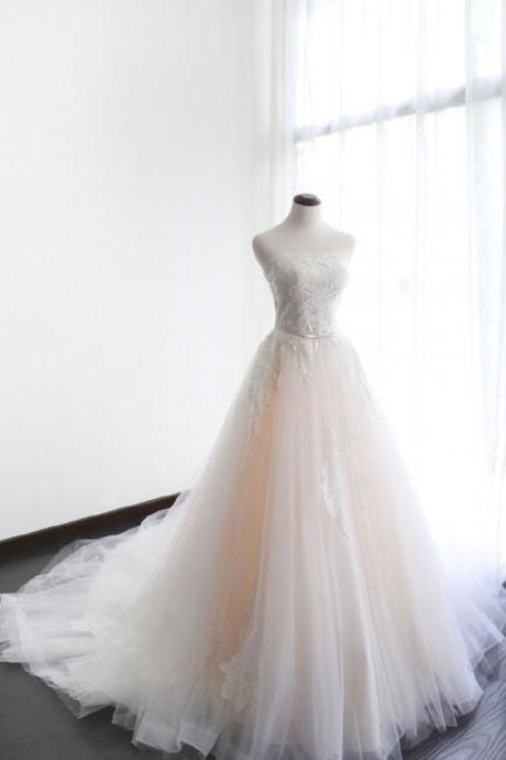 Lace Appliqués Strapless Straight Across Tulle Wedding Gown Featuring Train